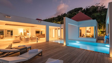 Ultraluxe Villa Eclipse - ERVR - Living room pool night.jpg